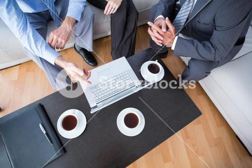 Business people with laptop and diary