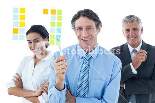 Smiling business people brainstorming together