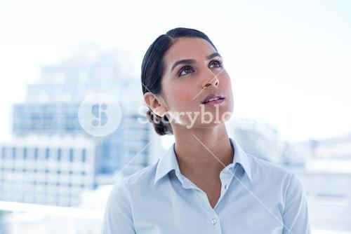 Thoughtful businesswoman looking away