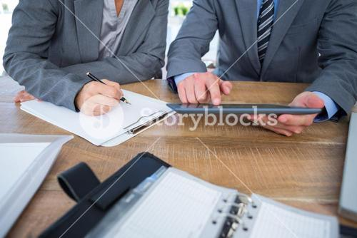 Business people using tablet in office