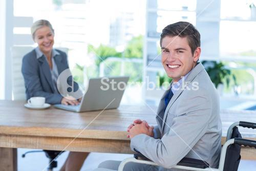 Disabled businessman working with partner