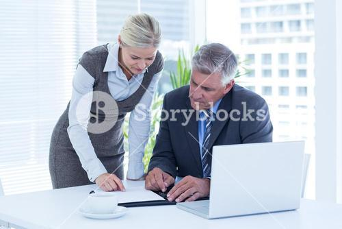 Businessman with secretary checking diary