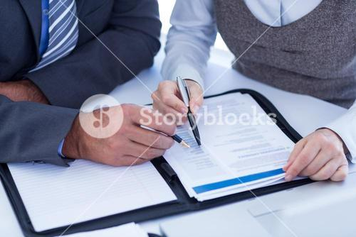 Business people checking file