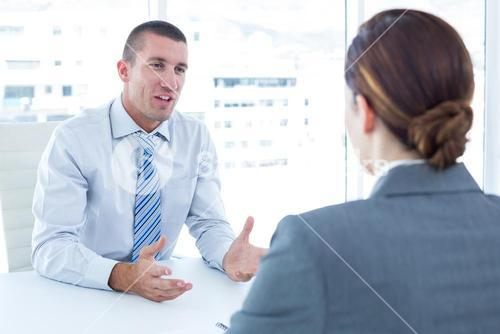 Businessman conducting an interview with businesswoman