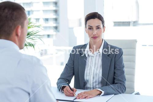 Businesswoman conducting an interview with businessman