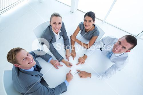 Business team pointing clipboard