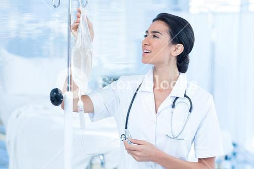 Nurse connecting an intravenous drip