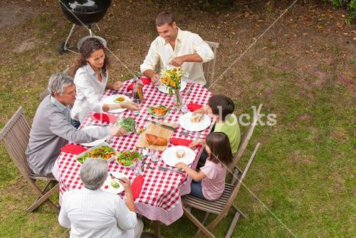 Family eating outside in the garden