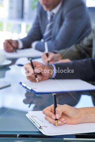 Business team redacting contracts
