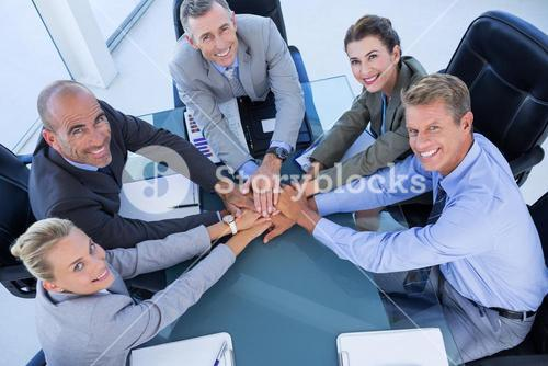Employees putting hands together