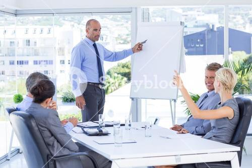 Businesswoman asking question during meeting