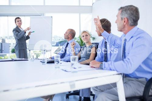 Businessman asking question during meeting