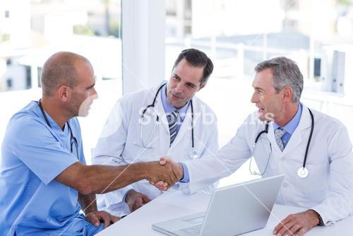 Doctors doing hands shakes