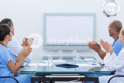 Team of doctor applauding during meeting