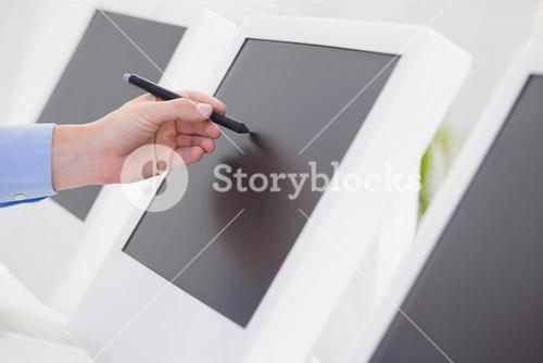 Businessman pointing his screen