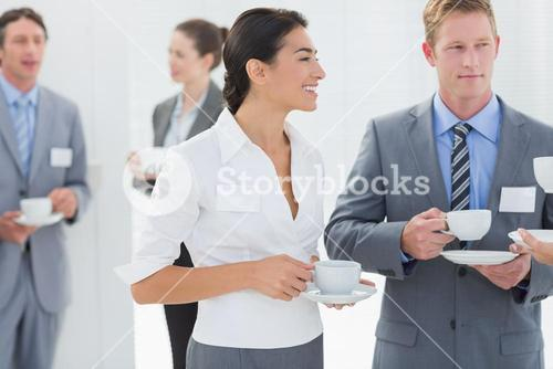 Business people drinking cup of coffee