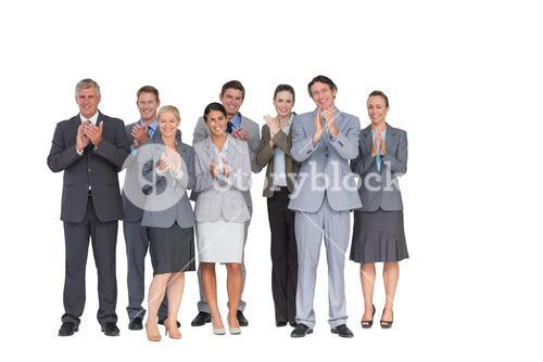 Smiling business team applauding at camera