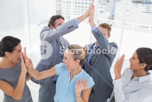 Excited business team cheering