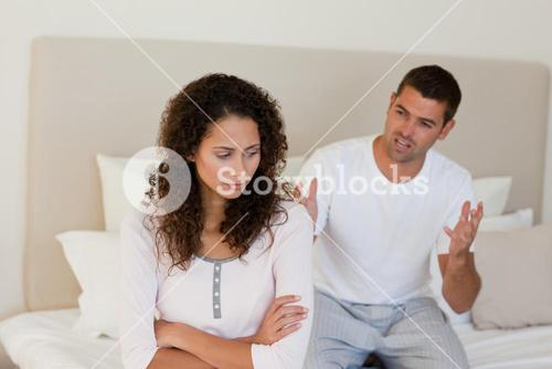 Young couple having a dispute on the bed