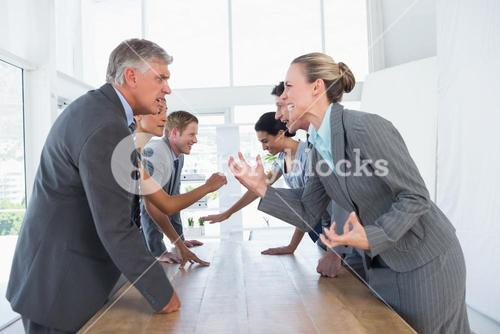 Irritated business team arguing