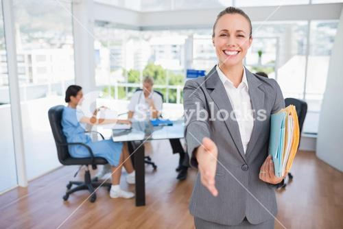 Smiling businesswoman introducing herself