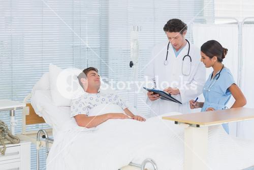 Doctors taking care of patient