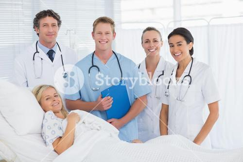 Team of doctor and patient looking at camera
