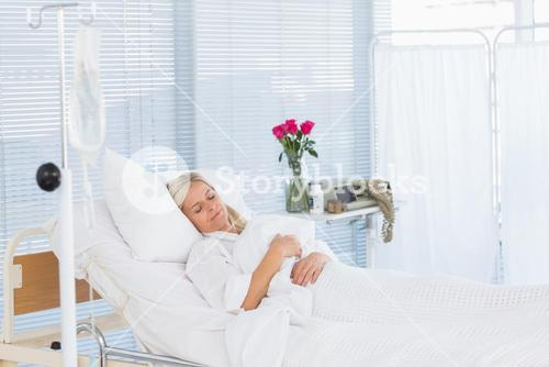 Happy patient lying on her bed