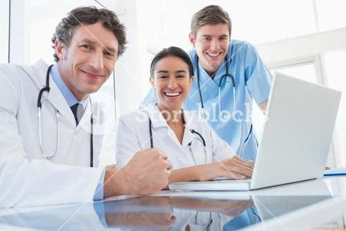 Team of doctors smiling at camera