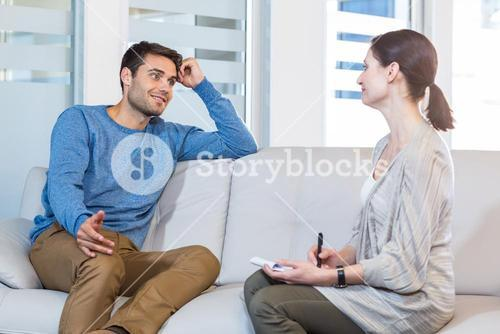 Psychologist talking with happy man