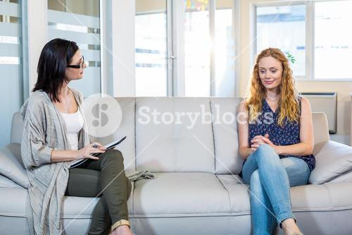 Psychologist talking with happy woman
