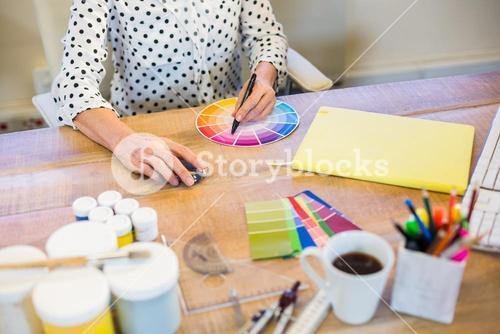 Casual businesswoman working with colour chart