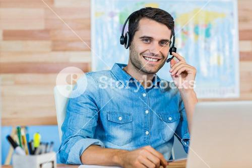 Handsome travel agent smiling at camera