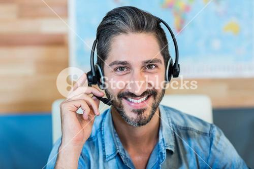 Smiling travel agent looking at camera