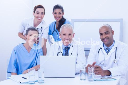 Team of doctors working on laptop