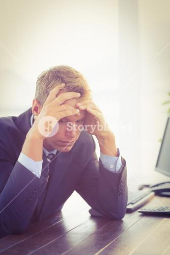 Irritated businessman looking his desk