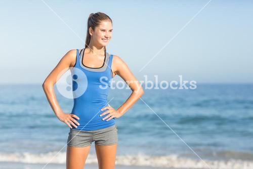 Portrait of beautiful fit woman with hands on hips