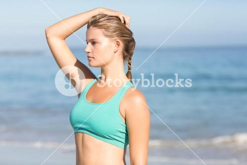 Beautiful fit woman relaxing at the beach