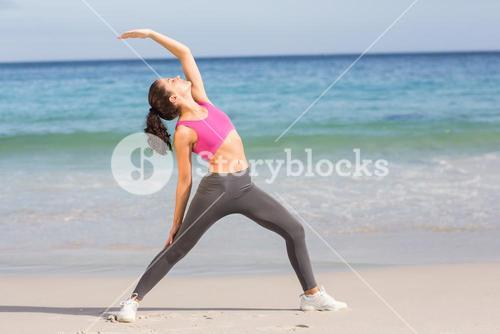 Fit woman stretching her back