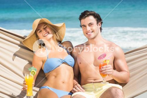 Happy couple relaxing on the hammock