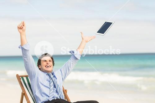 Businessman launching his tablet computer