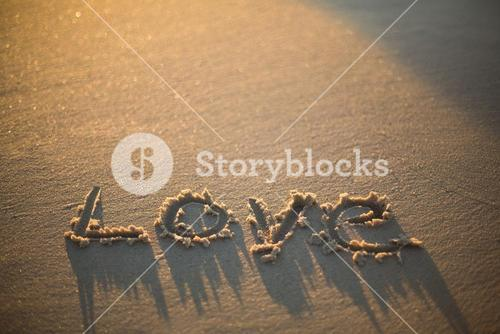 love written on the beach