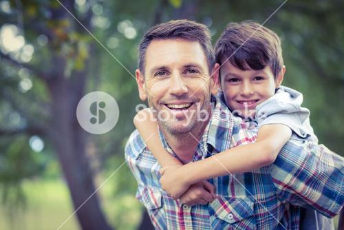 Child playing with his father