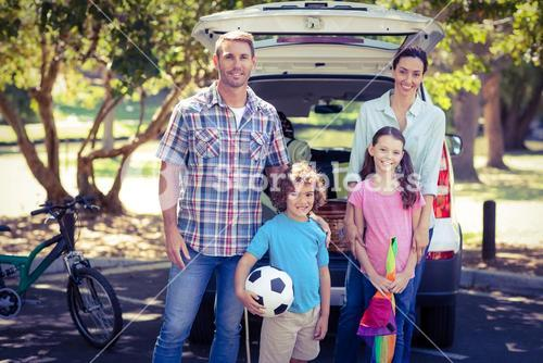 Happy family going for a camping in the park