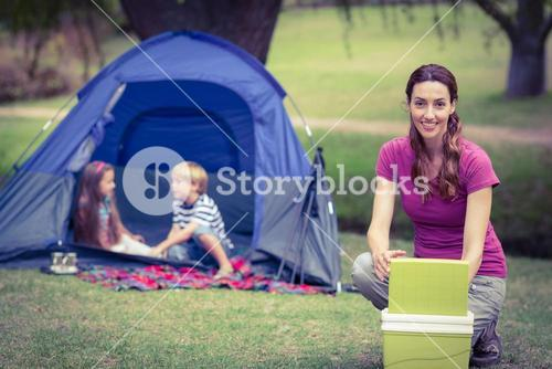 Mother and children camping in the park