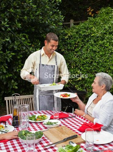 Man serving his family at the table