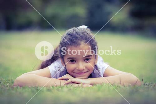 Smiling little girl looking at the camera