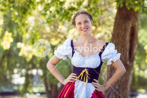 Pretty oktoberfest blonde smiling in the park
