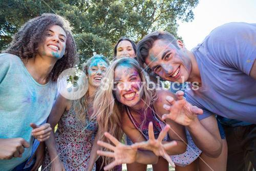 Happy friends covered in powder paint