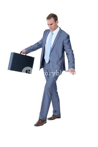 Businessman walking in equilibrium with suitcase